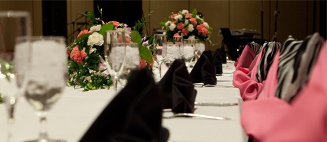 Formal dinner setting at a catered event in a ballroom inside Santa Fe Station Hotel & Casino