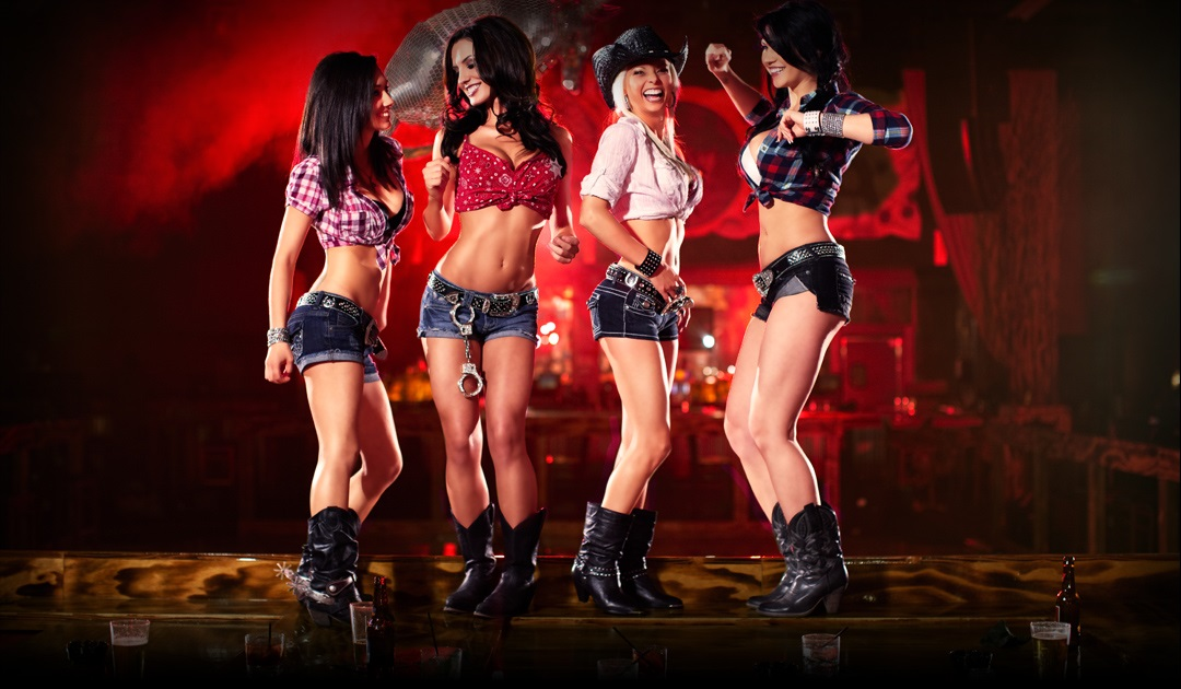 The beautiful Girls of Revolver in Daisy Dukes and Cowboy hats